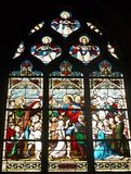 Stained-glass. Surface is made up of multi-colored, artistically-designed glass bonded with lead tape and serving for glazing of windows. Shot in Paris Stock Image