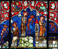 Stained Glass - The Temptation of Christ. Stained glass depicting The Temptation of Christ by the Devil in the cathedral of Strasbourg, France royalty free stock photo