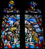 Stained Glass in Tubingen - Creation. Stained Glass in the Stiftskirche Church in Tubingen, depicting Creation, with birds, fish, mammals en two children playing Royalty Free Stock Photo