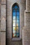 Stained-glass vitrage window. In catholic church Royalty Free Stock Image