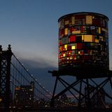 Stained Glass Water Tower. In Brooklyn, NY, next to Manhattan Bridge & NYC skyline Royalty Free Stock Photos