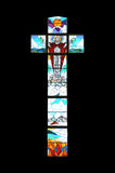 Stained glass window. Crucifix shaped stained glass window on church in Dominican Republic Stock Photography
