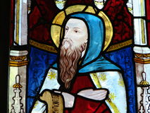 Stained glass window. Stained glass church window portrays a bearded man.  Southwest England Royalty Free Stock Photos