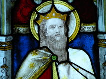 Stained glass window. Colorful bearded king with crown on stained glass church window Royalty Free Stock Photo