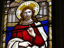 Stained glass window. Details of religious art in a church stained glass window.  Possible image of Jesus Stock Photography