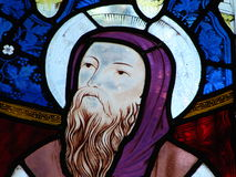 Stained glass window. Colorful biblical figure on stained glass window in church Stock Photography