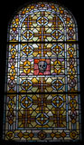 Stained glass window. Stained glass classic art window in old chapel, featuring a red and black skull at Sacred Heart Cathedral, Paris, France stock photography