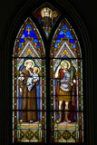 Stained glass window. Colorful stained glass window depicting St. Antonius de Padua and St. Mauritius Royalty Free Stock Images