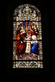 Stained glass window. Beautiful painted stained glass window with christian image royalty free stock images