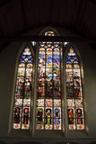 Stained glass window. View of a stained glass window from inside a church Stock Image