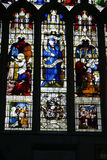 Stained Glass Window. Showing Biblical and monastic scenes stock photo