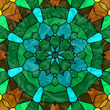 Stained Glass Window. Pretty stained glass kaleidoscope in hues of green, cyan and brown Stock Photography