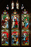 Stained glass window. A stained glass church window depicting religious scenes stock photo