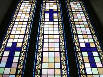 Stained glass window. A stained glass window with three crucifix Royalty Free Stock Image