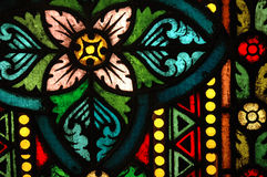 Stained Glass Window. Colourful stained glass window depicting simple pink flower Stock Photography