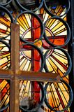 Stained glass window. With a cross out the focus royalty free stock photography
