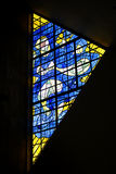 Stained glass window. Abstract design in yellow and blue in trangular stained glass window Stock Images