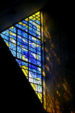 Stained glass window. Abstract design in yellow and blue with sun shining through stained glass Royalty Free Stock Images