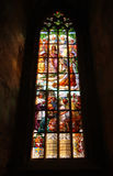 Stained glass window. Historical stained glass window with religious scene and its reflection on a wall Stock Image