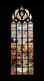 Stained glass window. Historical stained glass window with religious scene Stock Images