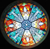 Stained-glass window. A round stained-glass window is in the dome of church Stock Photos