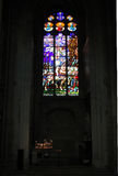 Stained glass Window and Altar candles. Royalty Free Stock Photography