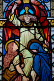 Stained Glass Window Angel, Virgin Mary and Saint. A Victorian stained Glass window made in hte mid 19th century depicting an angel pointing to heaven with Saint royalty free stock photos