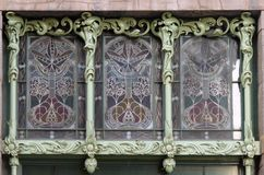 Stained glass window in Art Nouveau. Stile. Element of the decoration of the facade of the Eliseevsky store in St. Petersburg royalty free stock photography