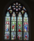Stained glass window in Ballybrack Church, County Dublin royalty free stock photo