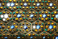 Stained glass window with bits of glass yellow, blue and green Royalty Free Stock Photo