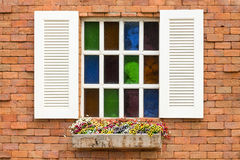 Stained Glass Window. On brick wall royalty free stock photography