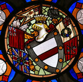 Stained Glass window in the Cathedral of Burgos. Stained Glass window depicting a Coat of Arms with the Union Jack and a pirate flag in the Cathedral of Burgos royalty free stock photography