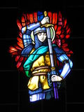 Stained glass window of knight in church Stock Images