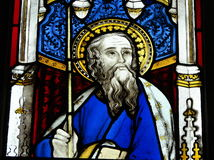 Stained glass window in church. Colorful stained glass window in church depicting Jesus Christ or God Stock Photos