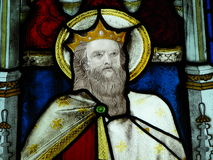 Stained glass window in church. Biblical figure on stained glass window in church Stock Image