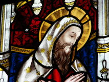 Stained glass window in church. Image of Jesus Christ on colourful stained glass window in church Royalty Free Stock Photo