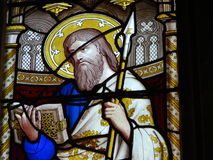 Stained glass window in church. Image of biblical figure with halo on stained glass window in church Stock Photo