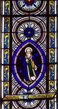 Stained glass window in church. Figure of Bartholomew the Apostle or Saint Bartholomew on colorful stained glass window in church stock photos