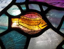 Stained glass window in church stock photos
