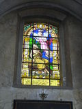 Stained-glass window. Window in the church. Beautiful stained glass window on religious subjects Royalty Free Stock Photos