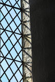 Stained glass window in church, Bibury England. Architecture detail. Stained glass window in St Mary Parish Church Bibury, England Stock Photo