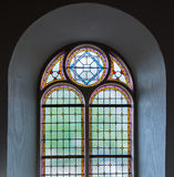 Stained glass window in a church. Colorful leaded glass window in a Dutch church from close Royalty Free Stock Photos