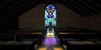 Stained Glass Window Church. A dim old church interior lit by suns rays penetrating through a stained glass window in amongst rows of church pews Royalty Free Stock Photos