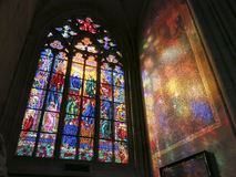 Stained glass window in a church. Light reflected through a stained glass window in a church Royalty Free Stock Photo