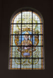 Stained glass window in church Notre-Dame aux Riches-Claires Royalty Free Stock Images