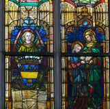 Stained Glass - Virgin Mary and Saint Ana. Stained Glass window in the Church of Saint Andrew in Antwerp, Belgium, depicting an Angel and the Virgin Mary and her royalty free stock photography