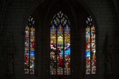 Stained glass window in Church of St Etienne. Stock Photo
