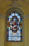 Stained glass window in Collegiate church of Saint-Denis of Liege. LIEGE, BELGIUM-OCTOBER 19, 2014: Stained glass window in Collegiate church of Saint-Denis of Royalty Free Stock Photo