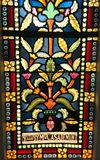 Stained glass window colors. An image of a beautifully coloured stained glass window in an old historic church of Singapore. Ornate floral and leaf motifs with Royalty Free Stock Photos