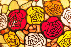 Stained glass window of colourful roses. Stock Photo